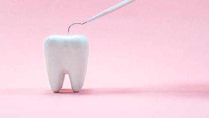 Зуб - фото 1