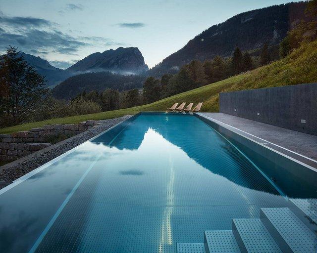 Архітектори створили дім для відпочинку біля Альп: яскраві фото - фото 294535