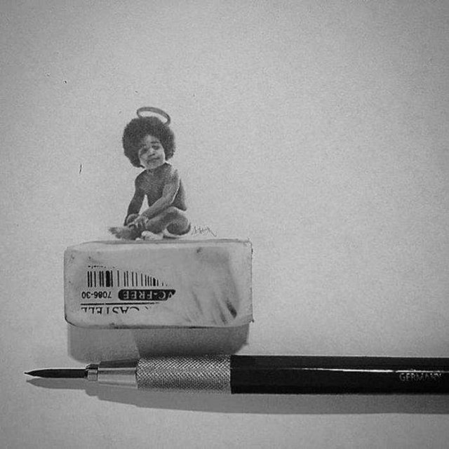 Американець створює мініатюрні малюнки з безліччю деталей - фото 299078