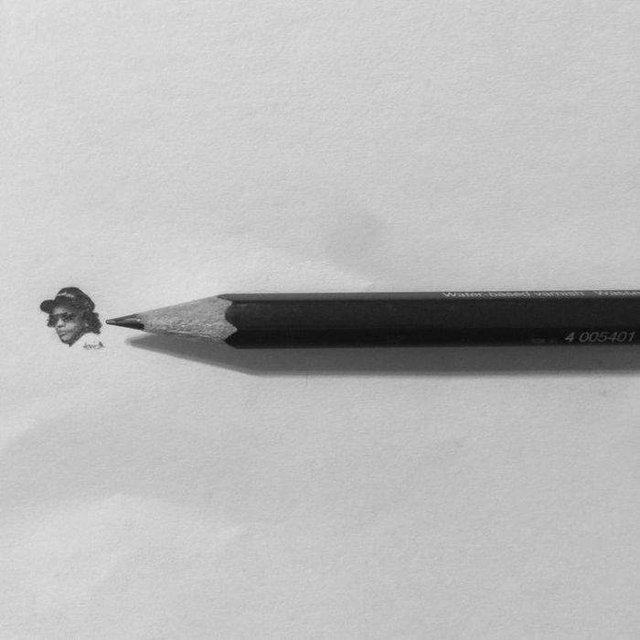 Американець створює мініатюрні малюнки з безліччю деталей - фото 299081