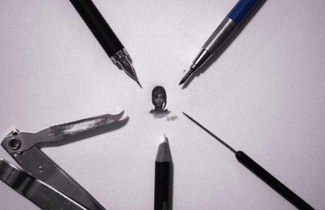Американець створює мініатюрні малюнки з безліччю деталей - фото 299083