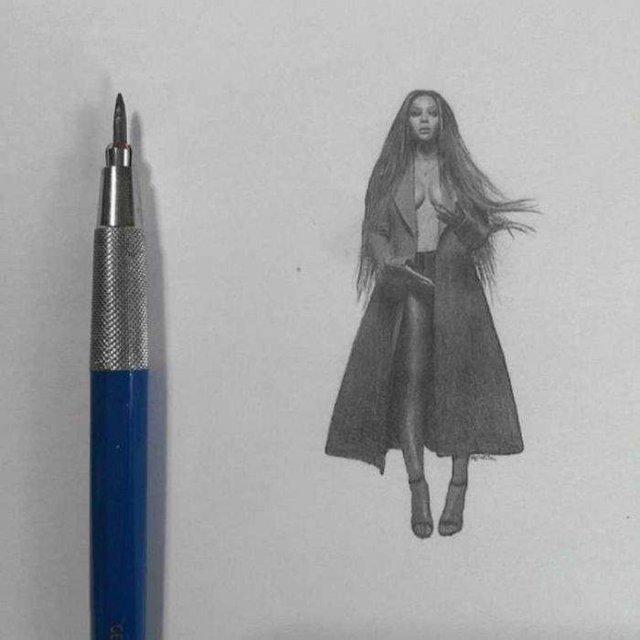 Американець створює мініатюрні малюнки з безліччю деталей - фото 299085