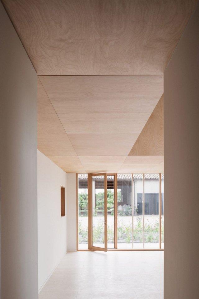 Архітектори зробили сучасний дім зі старого сараю - фото 299431