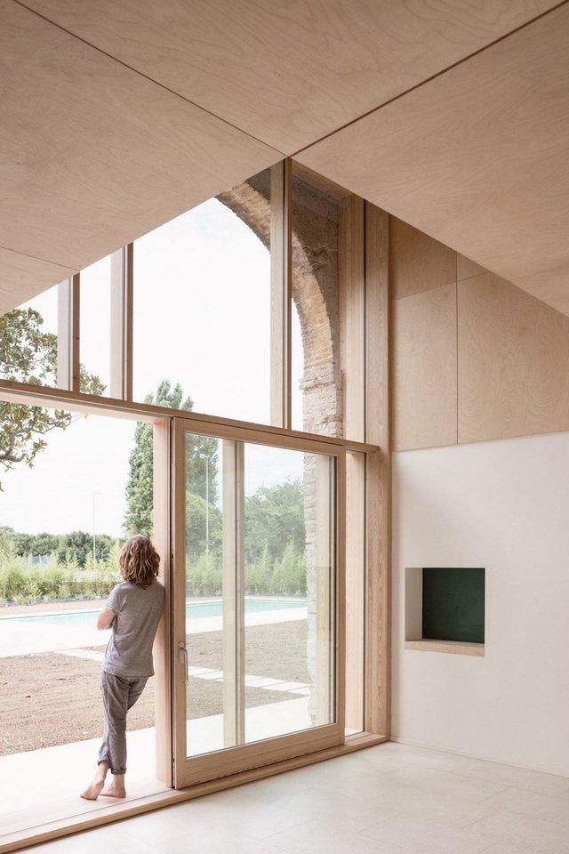 Архітектори зробили сучасний дім зі старого сараю - фото 299438