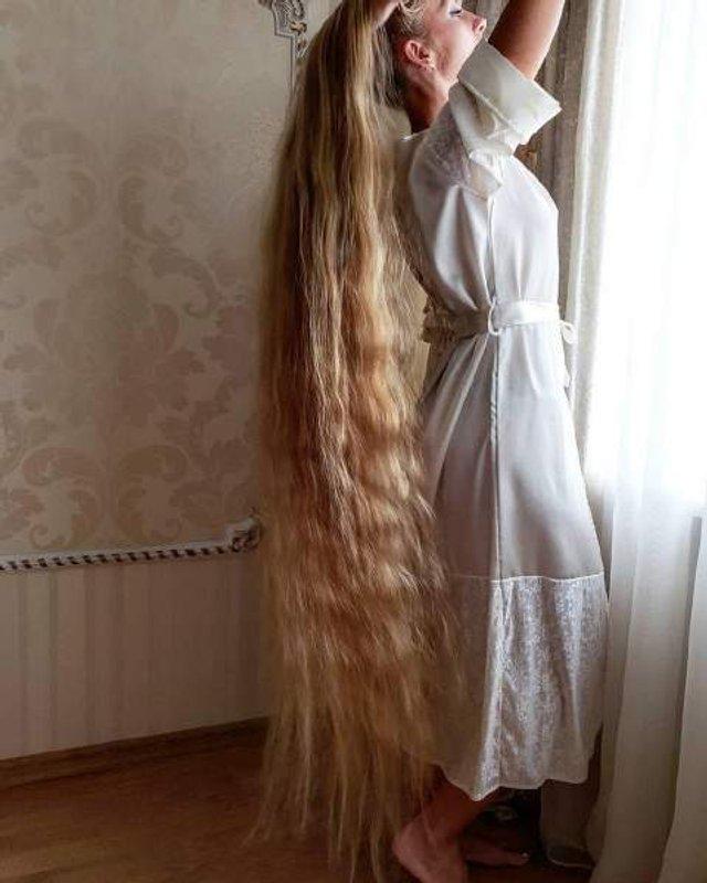 Українка, яка 28 років не стригла волосся, показала нові фото - фото 305641