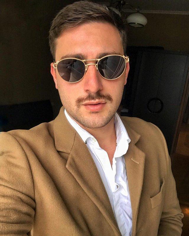 Як носити чоловічі сонцезахисні окуляри: правила етикету та трендові оправи - фото 329107