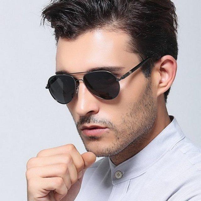 Як носити чоловічі сонцезахисні окуляри: правила етикету та трендові оправи - фото 329108