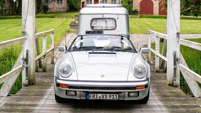 Тягач на мільйон: німець подорожує у фургончику, який везе Porsche 911 Speedster - фото 331435