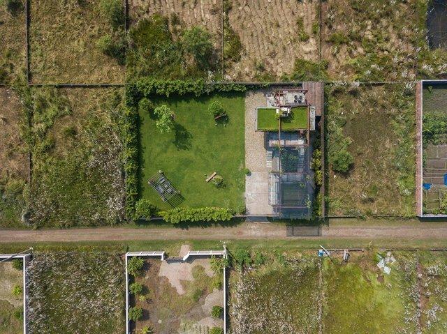 Як виглядає сучасний дім з вантажних контейнерів: яскраві фото - фото 331521