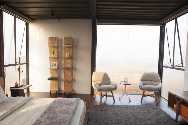 Як виглядає сучасний дім з вантажних контейнерів: яскраві фото - фото 331522
