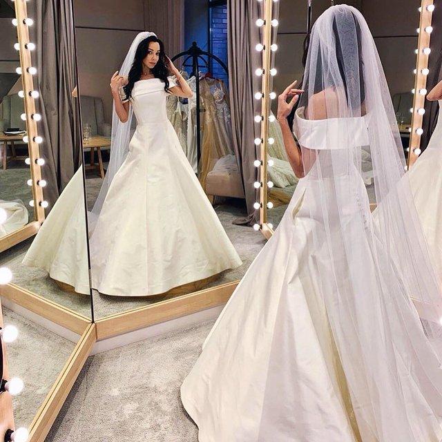 Катерина Кухар показала себе у весільній сукні - фото 332322