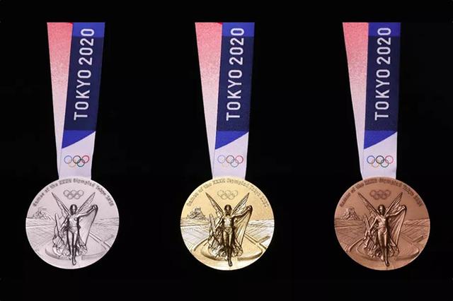 У Токіо показали олімпійські медалі зі старих телефонів - фото 343353