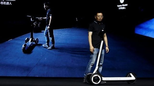 У Китаї представили незвичайний електроскутер: яка його фішка - фото 348987
