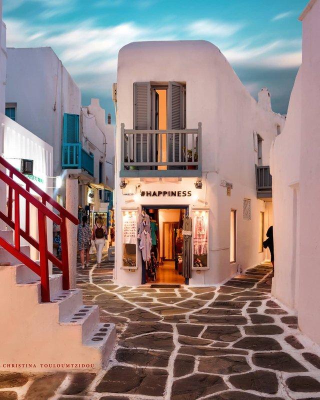 Як виглядає життя у Греції: яскраві вуличні фото - фото 383974