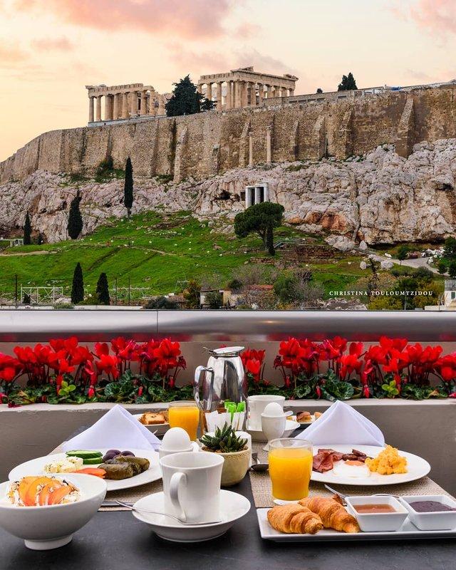 Як виглядає життя у Греції: яскраві вуличні фото - фото 383989