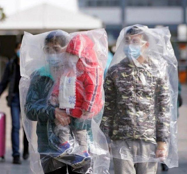 Як у Китаї захищаються від коронавірусу: фоторепортаж - фото 386570