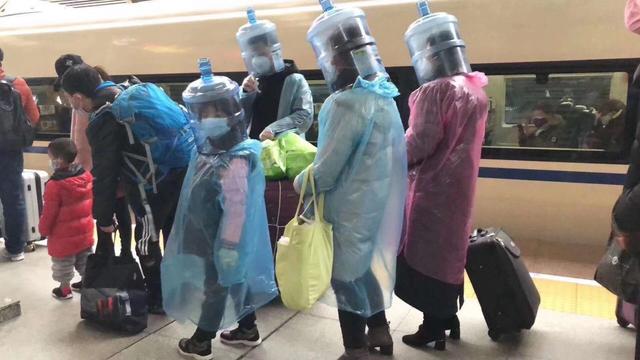 Як у Китаї захищаються від коронавірусу: фоторепортаж - фото 386572