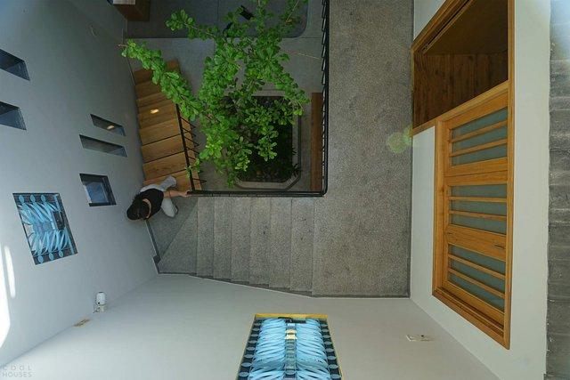 У В'єтнамі звели сучасний дім для любительки ромашок: ефектні фото - фото 390850