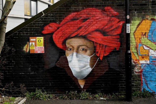 Потужні графіті про коронавірус: добірка фото з усього світу - фото 397605