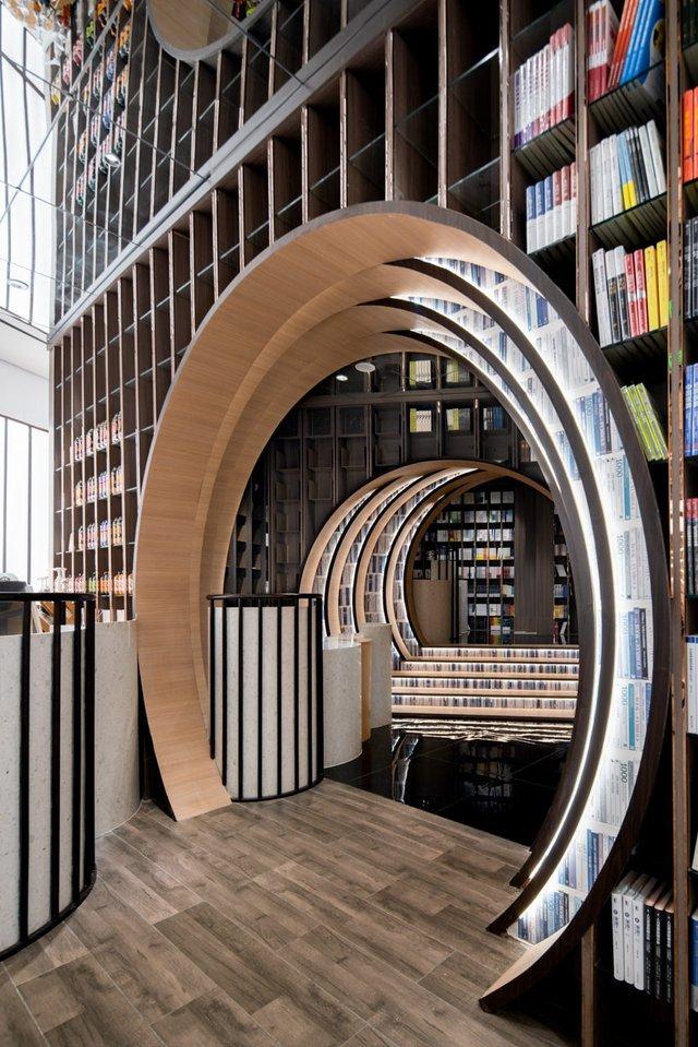 Книголюби оцінять: дивіться, як виглядає футуристична книгарня у Пекіні - фото 415194