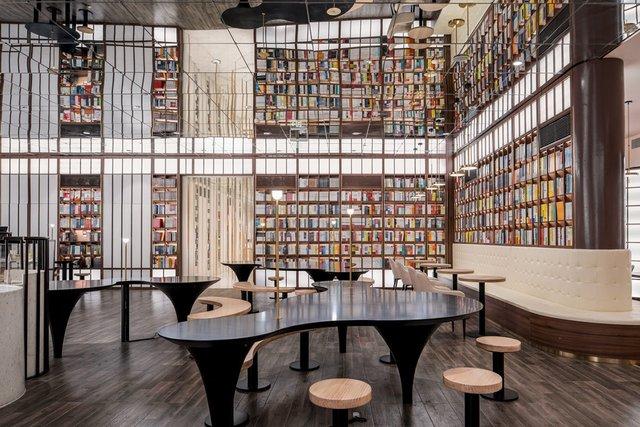 Книголюби оцінять: дивіться, як виглядає футуристична книгарня у Пекіні - фото 415195
