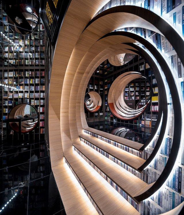 Книголюби оцінять: дивіться, як виглядає футуристична книгарня у Пекіні - фото 415197