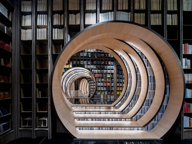 Книголюби оцінять: дивіться, як виглядає футуристична книгарня у Пекіні - фото 415198
