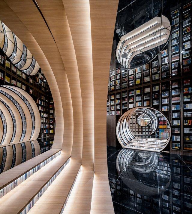 Книголюби оцінять: дивіться, як виглядає футуристична книгарня у Пекіні - фото 415202