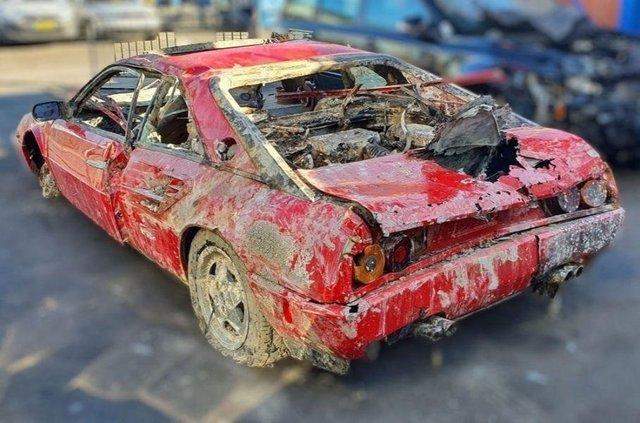 Викрадений 30 років тому Ferrari випадково знайшли аквалангісти: фотофакт - фото 417393