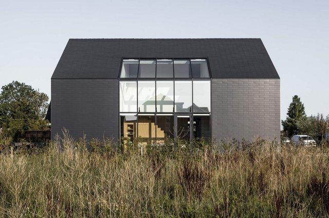 Як виглядає сучасна сімейна вілла у Нідерландах: фото - фото 418785