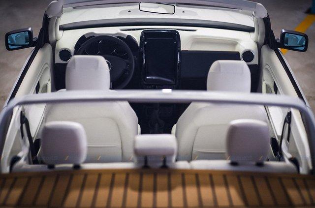 Дизайнери перетворили розбитий кросовер Dacia Duster на стильний кабріолет - фото 422401
