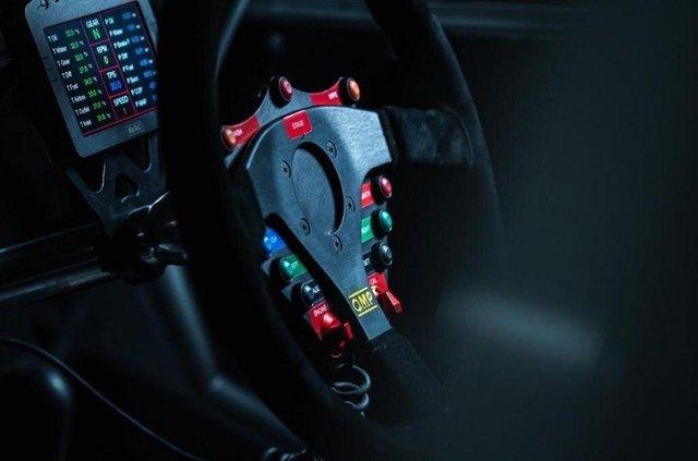 Сімейний мінівен Mitsubishi перетворили на авто для професійного ралі - фото 424328